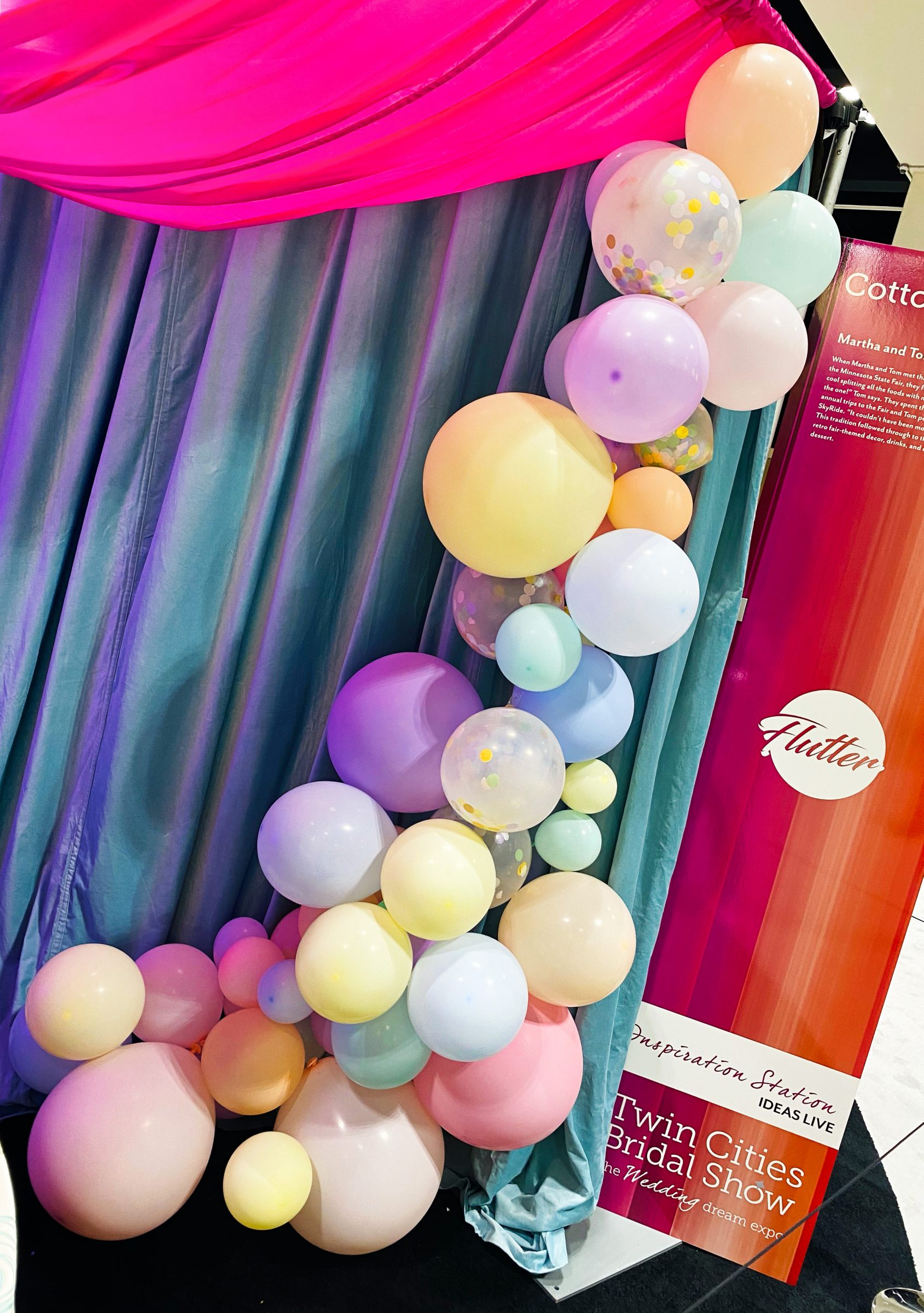 Light pink, blue, and yellow pastel balloon installation for wedding