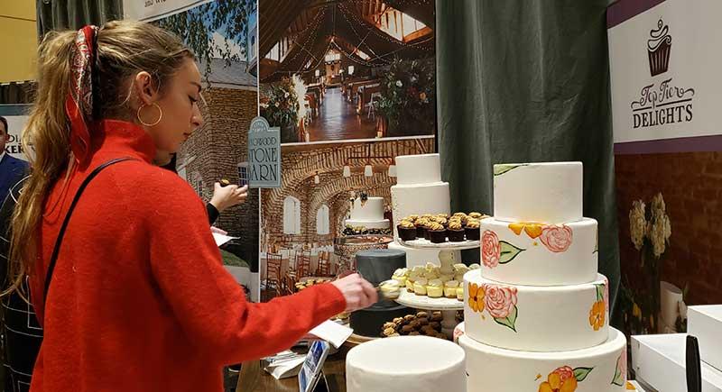 Bride tries cake samples