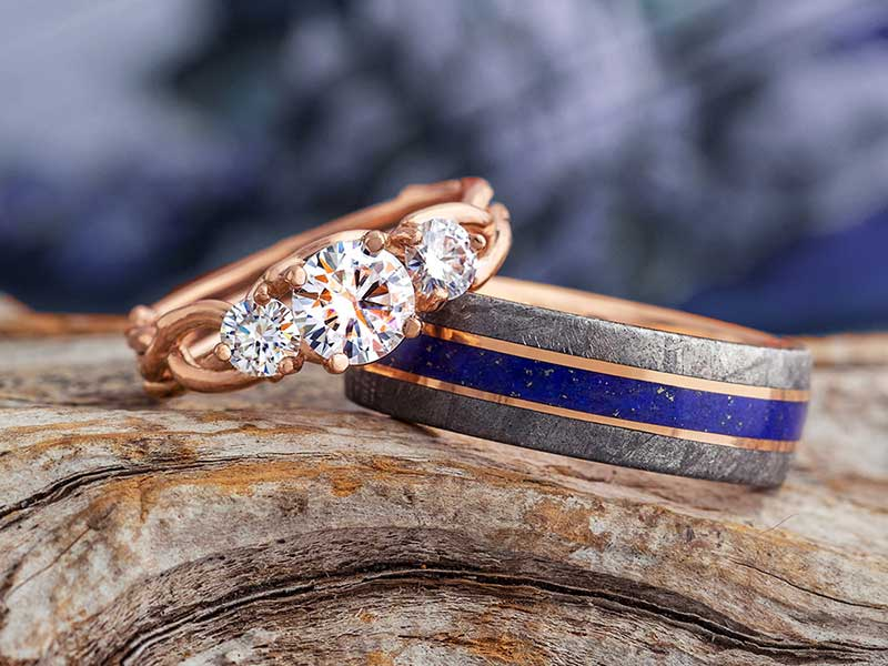 Rose gold diamond engagement ring with a blue and meteorite wedding band