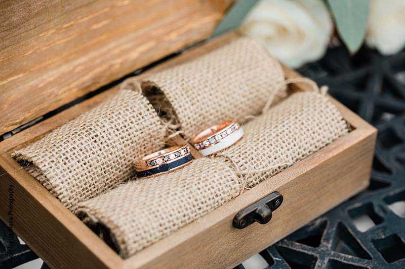 Custom groom's wedding rings in burlap ring box