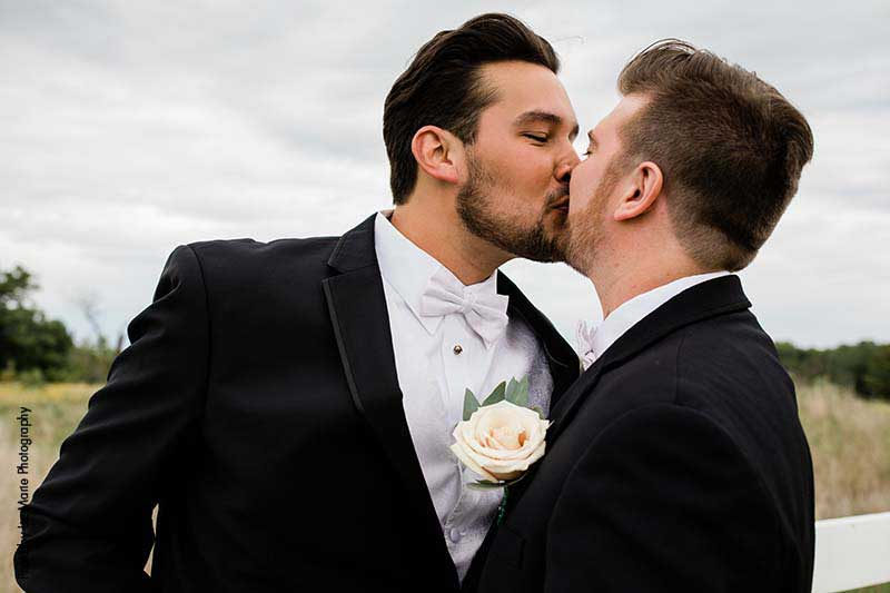 Grooms share kiss after first look