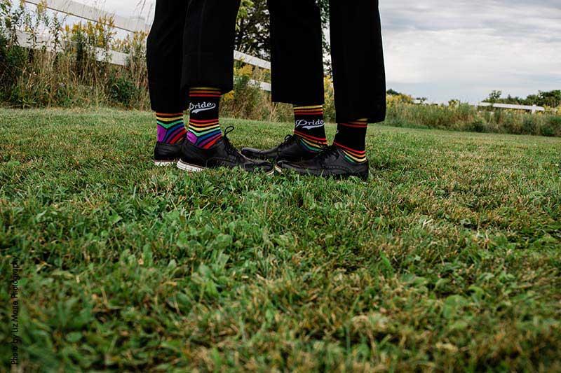 Grooms wear rainbow-striped socks