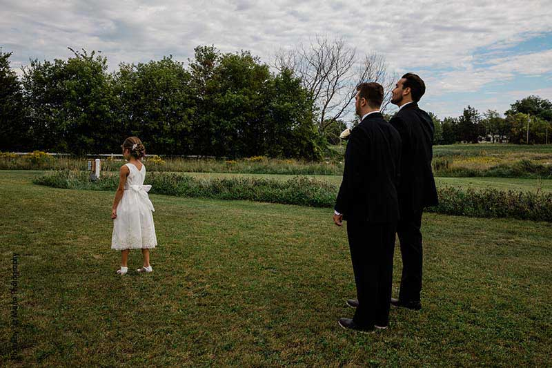 Grooms share first look with their daughter