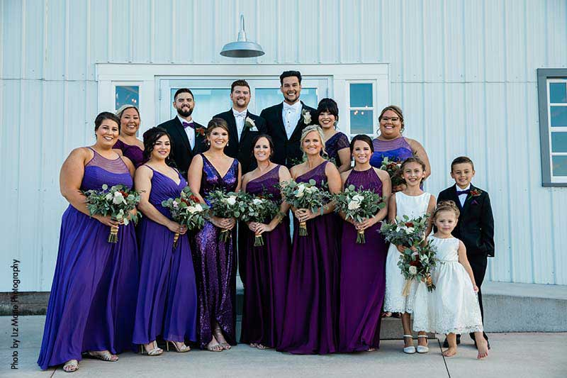 Wedding party with bridesmaids in purple dresses