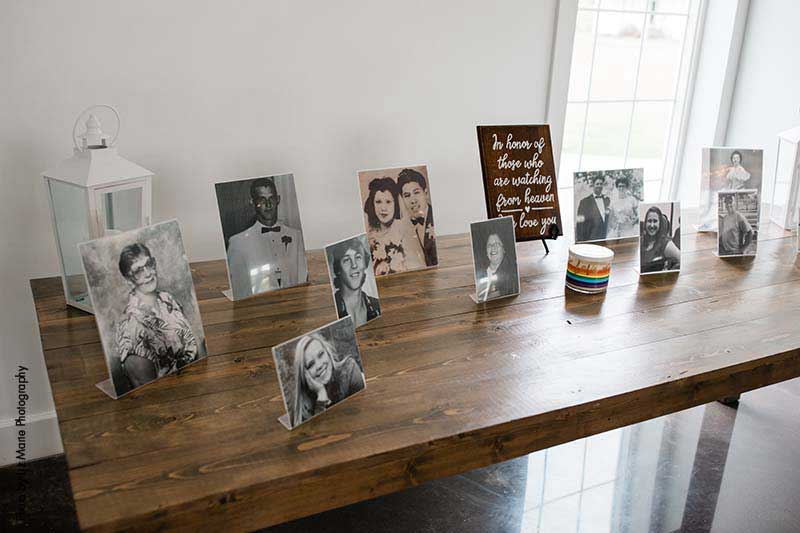 Wedding memorial table with pictures of family members that have passed