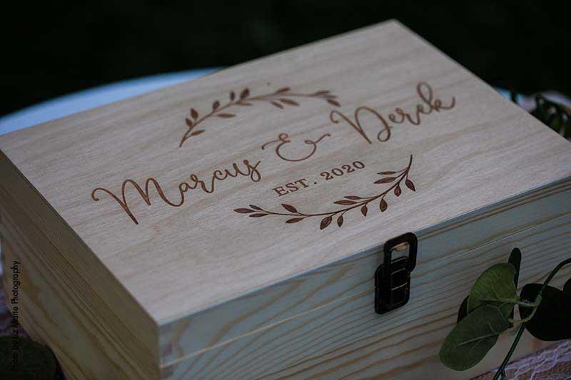 "Custom wooden wedding ring box that says ""Marcus & Derek"""