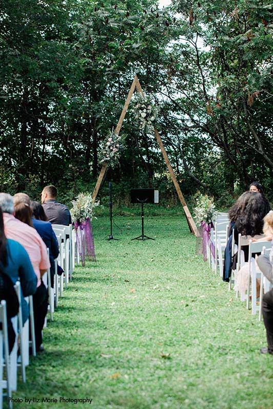 Triangle shaped geometric wedding arch for modern outdoor wedding