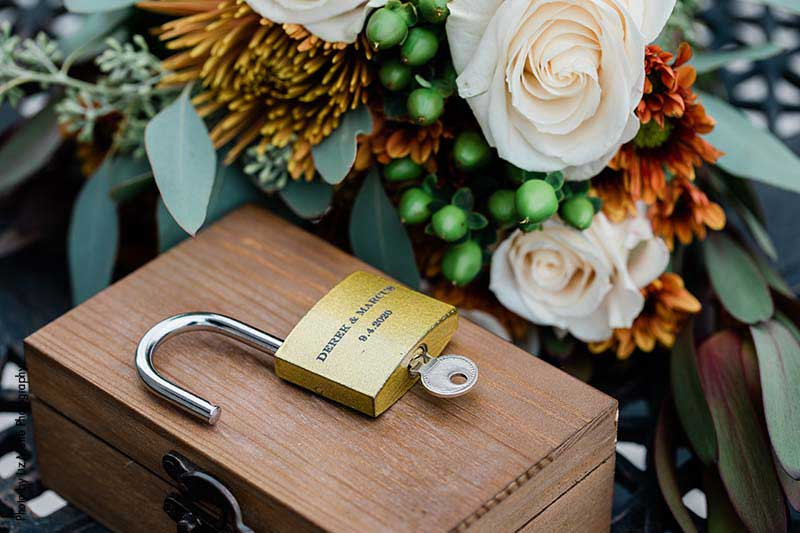 Lock with grooms' name on it with key