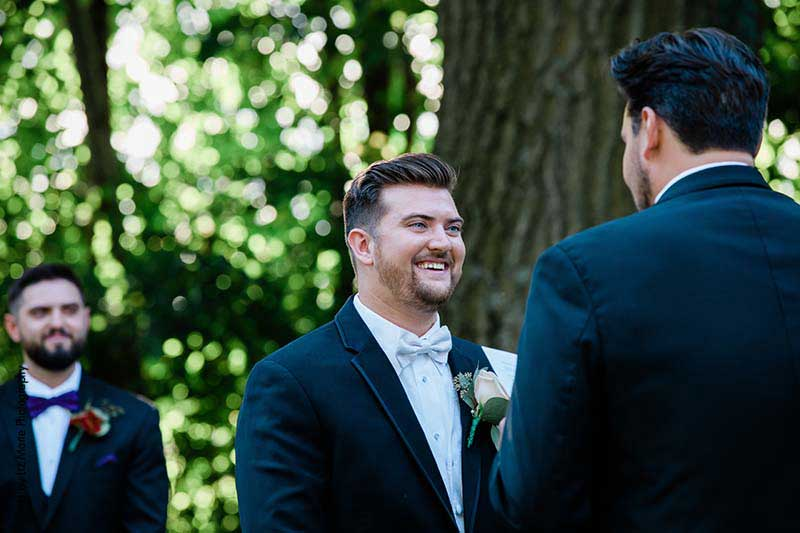 Two grooms in black tuxes