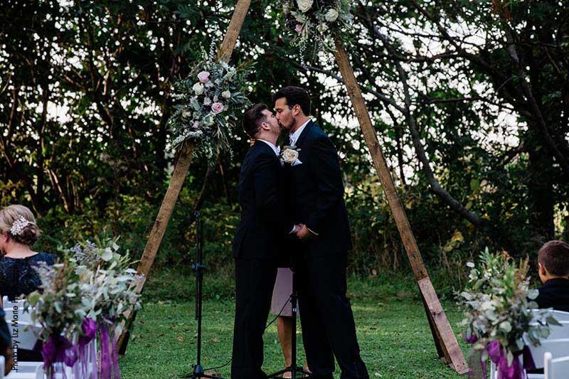 Triangle wedding arch at outdoor wedding