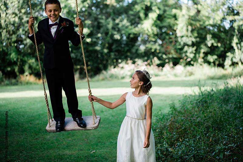 Flower girl and ring bearer on swing