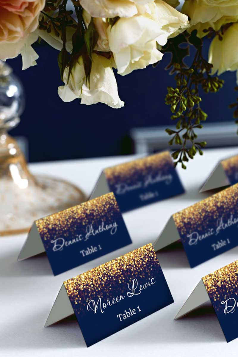 Navy blue and gold glitter table cards for wedding