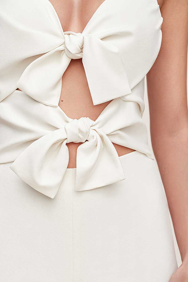 White jumpsuit with two large bows in front