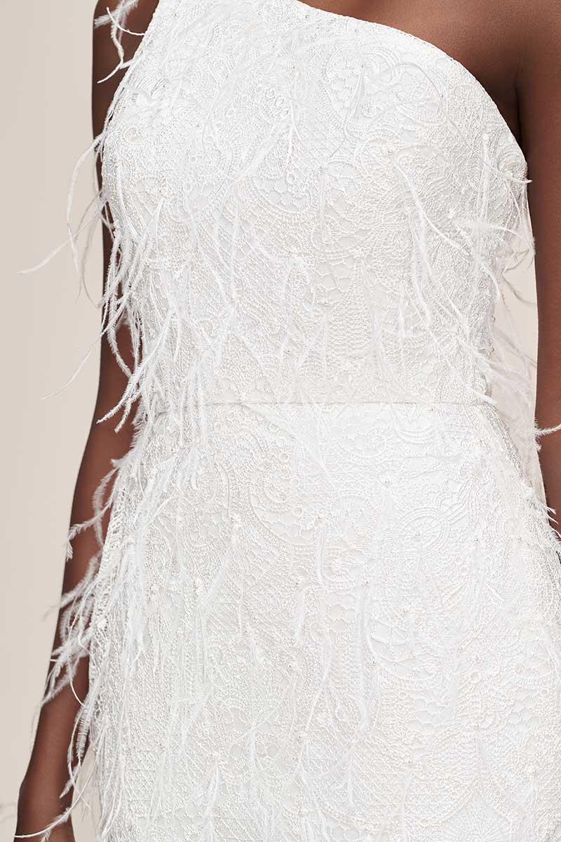 Above-the-knee, one-shoulder fringe white wedding dress