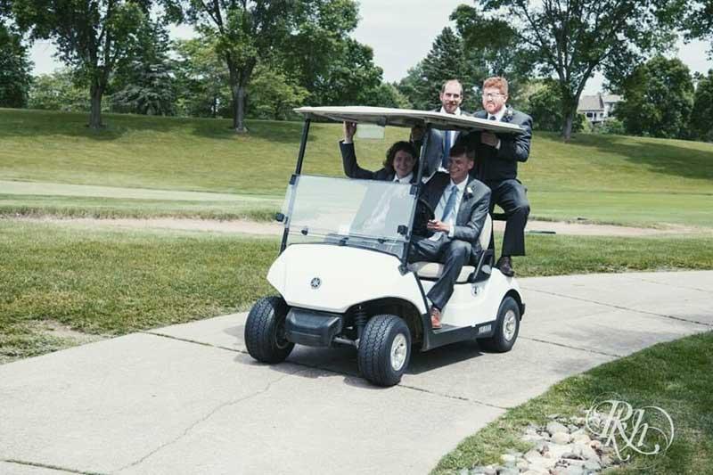 Groomsmen ride on golf cart at Oak Glen Golf Club