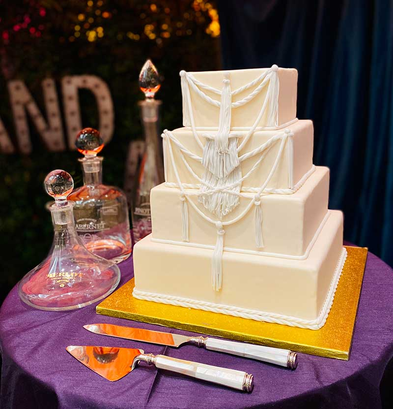 White and ivory 4-tier boho wedding cake by Keys Cafe & Baker