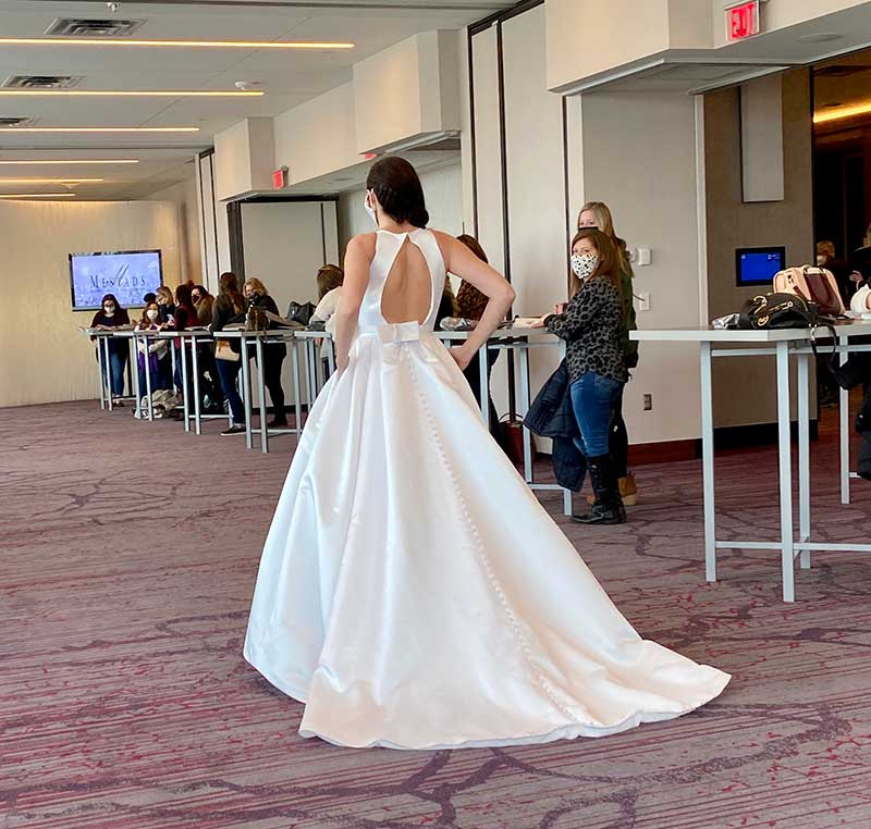 Classic white wedding ballgown on bridal fashion show runway