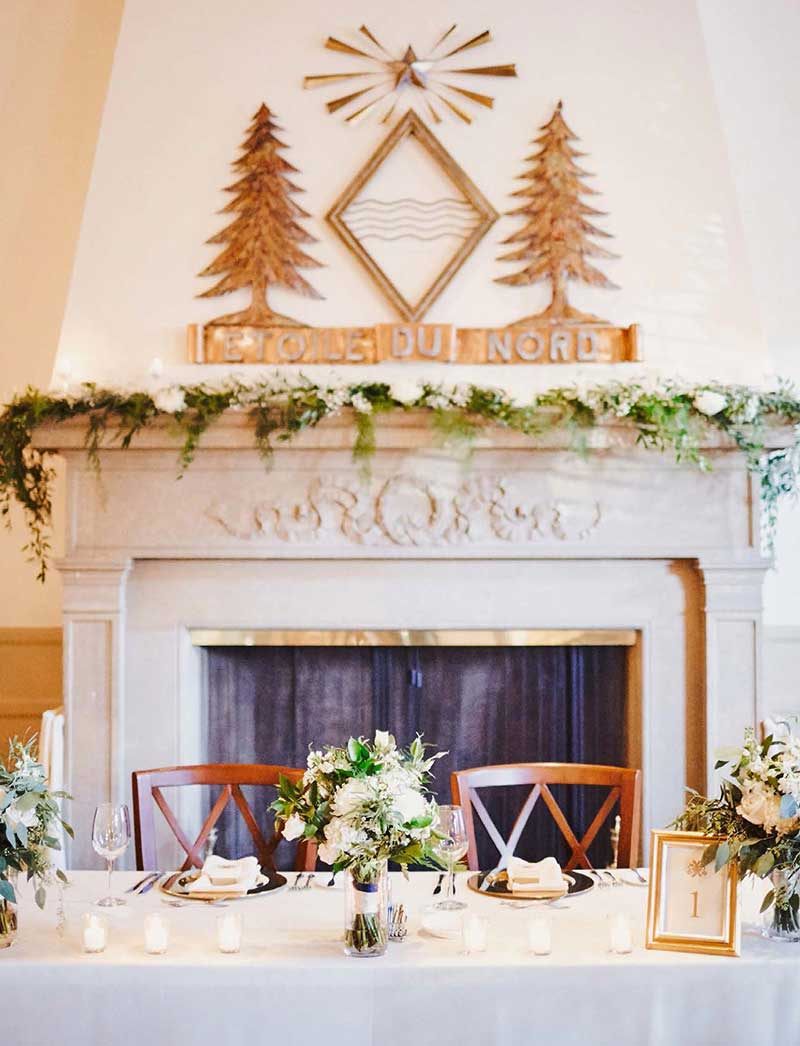 Sweetheart wedding table sits in front of historic fireplace in the Woman's Club of Minneapolis