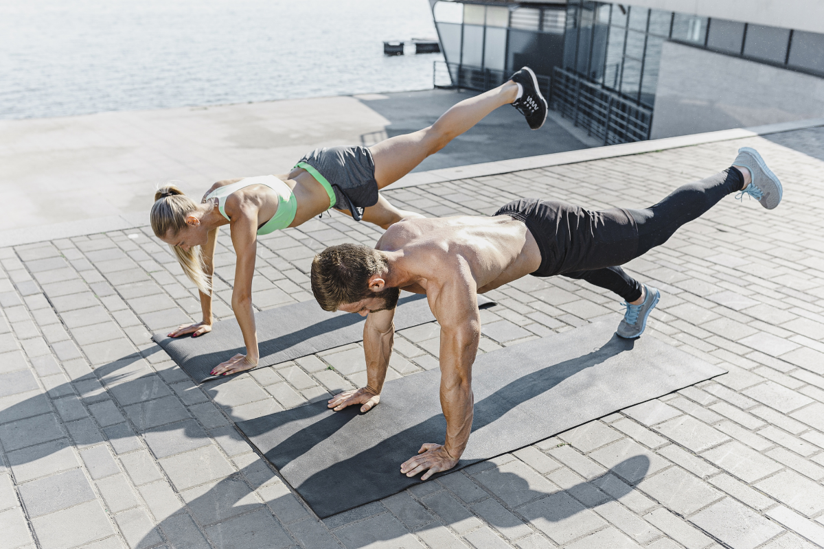 Couple works out outdoors