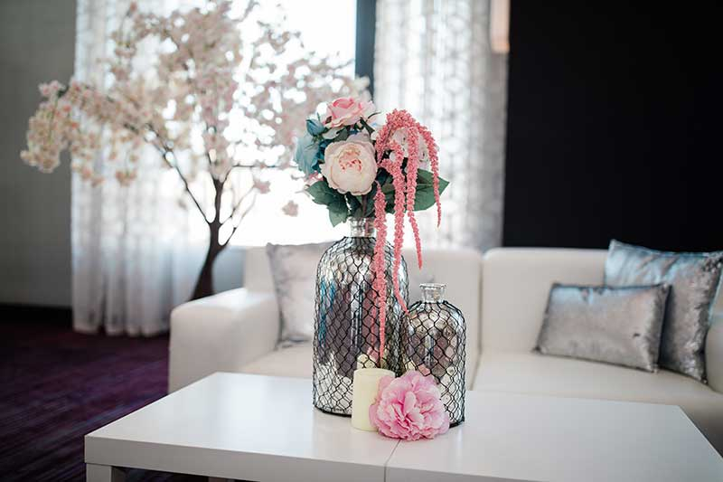 Pastel wedding flowers in silver caged vases