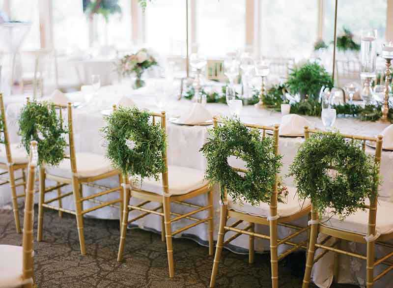 Wedding decor details in white, green, and gold