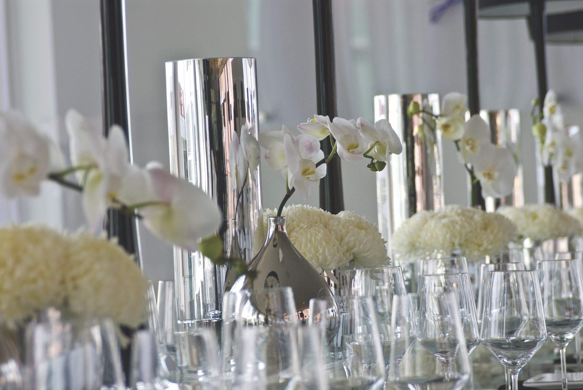 Wedding tabletop with clear glassware and white flowers