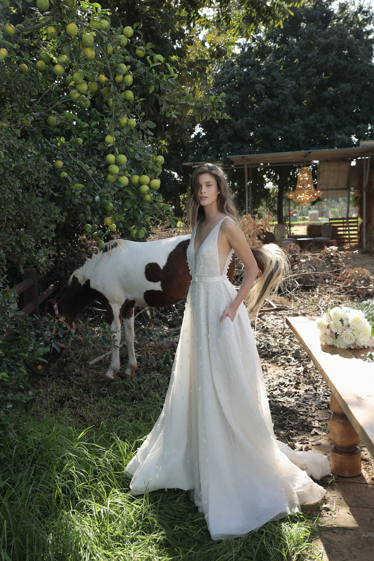 Tulle wedding dress with v-neck and back opening