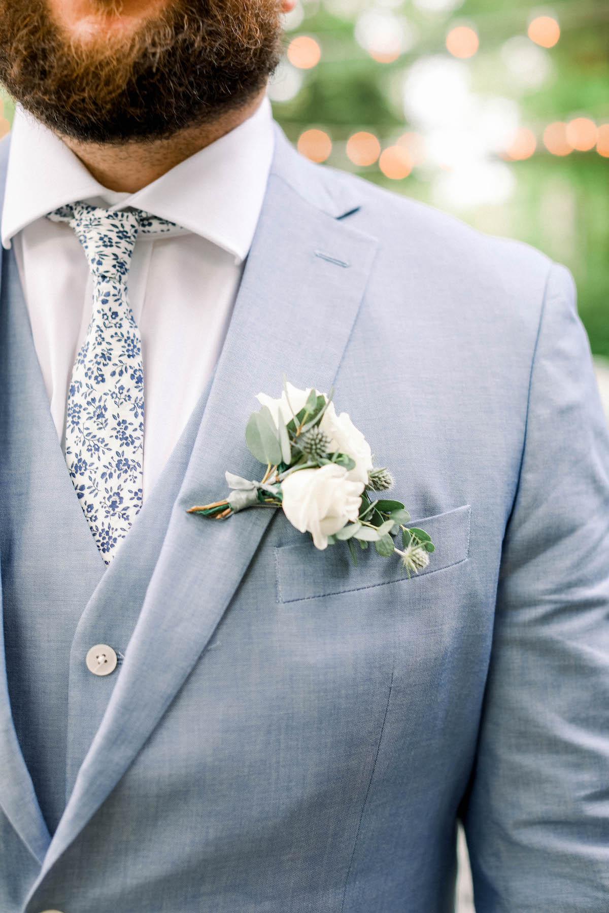 Groom in blue suit for spring wedding colors