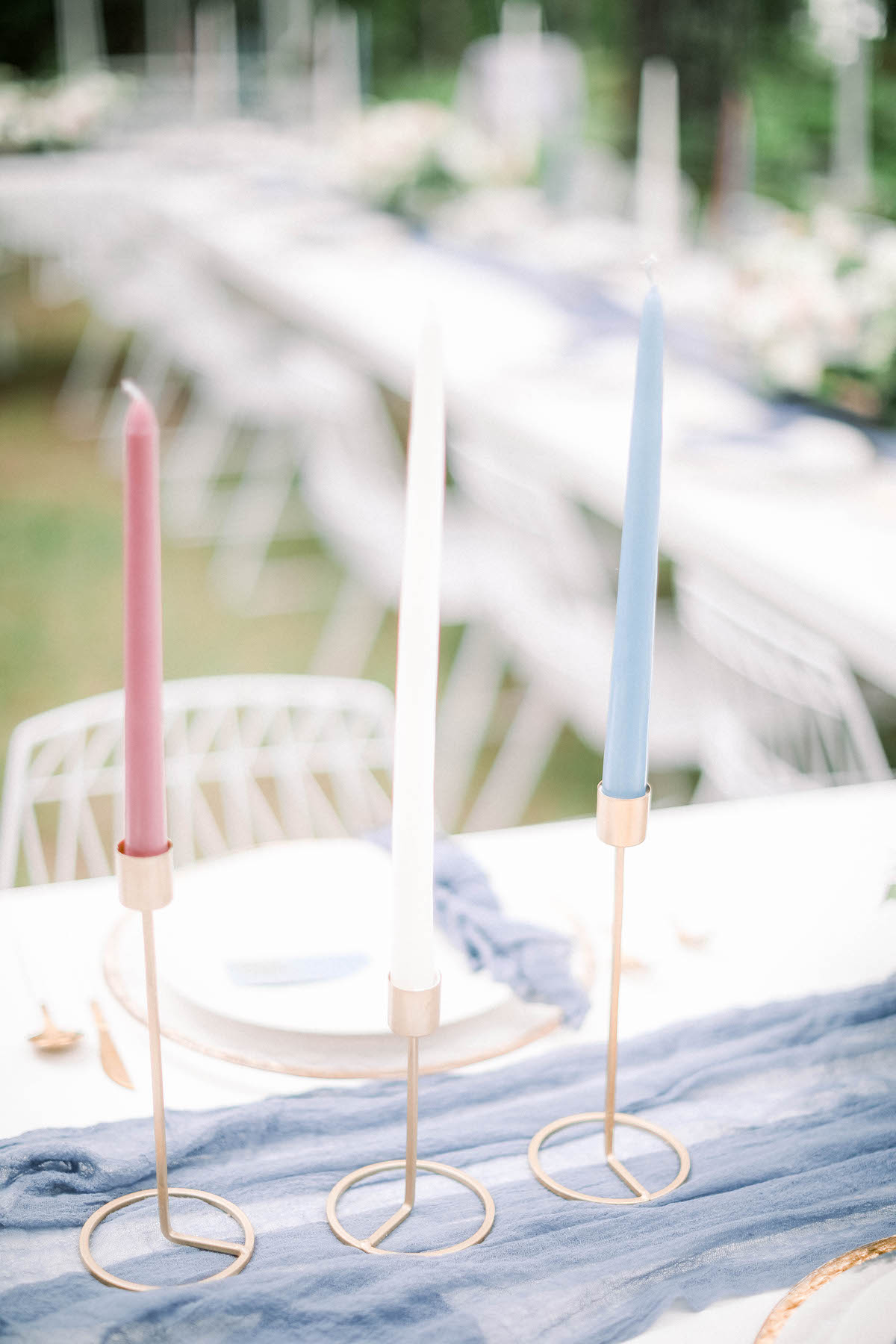 Blue, white, and red taper candle wedding decor