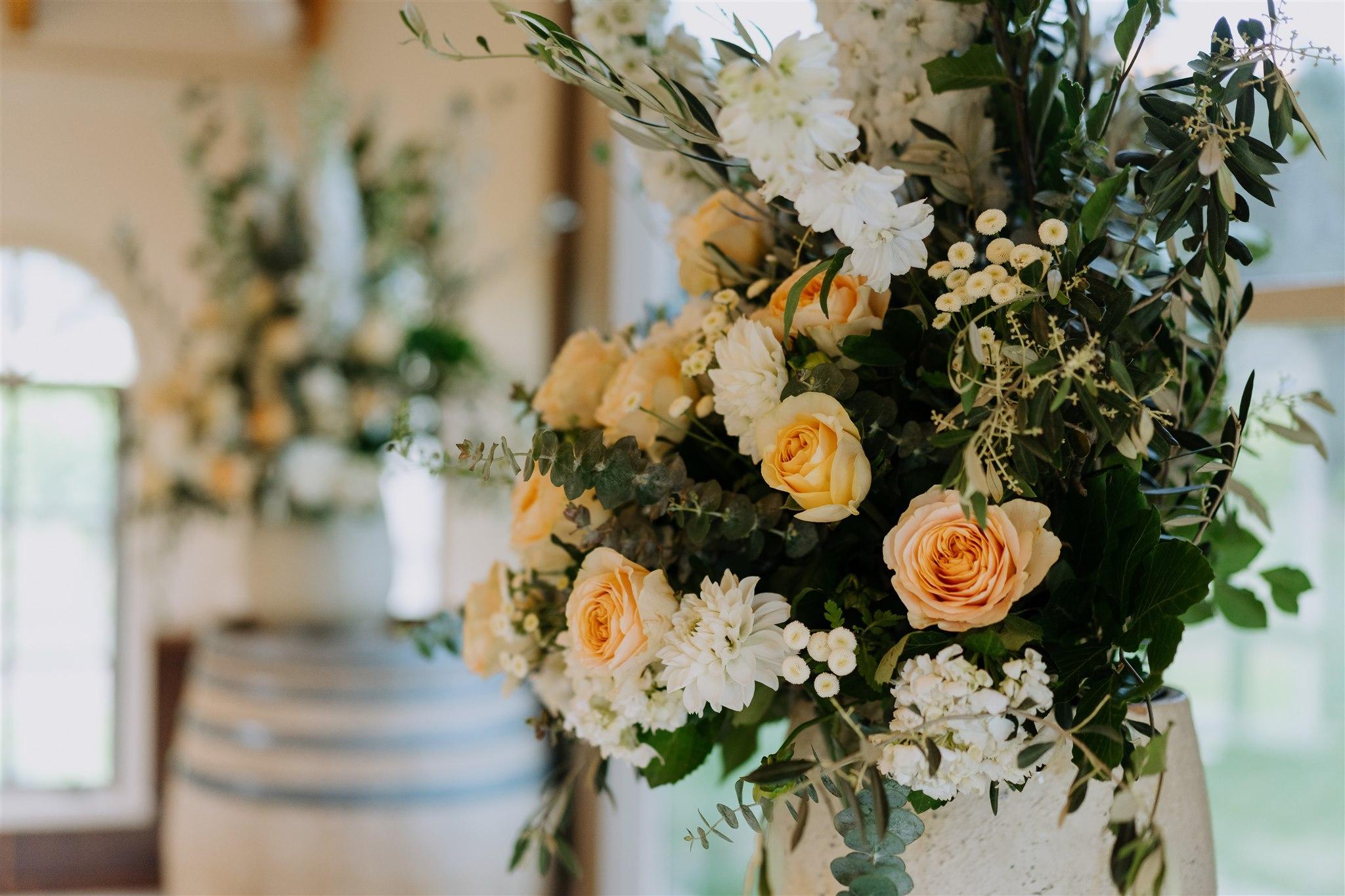 Peach and greenery wedding reception decor
