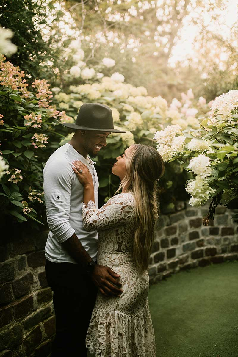 Couples takes engagement photos in garden