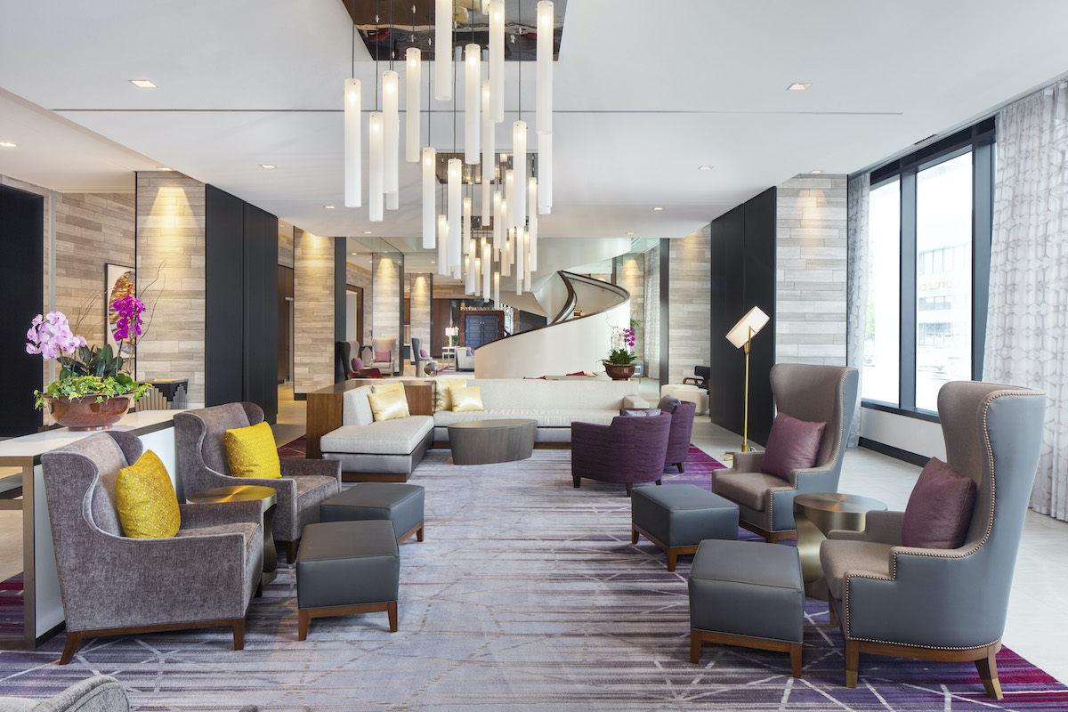 Stylish hotel lobby with modern decor and chandeliers in downtown Rochester, Minnesota