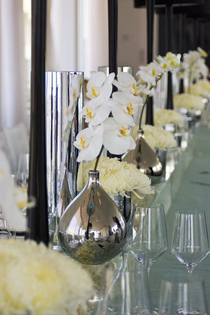 Silver vase with orchids at wedding