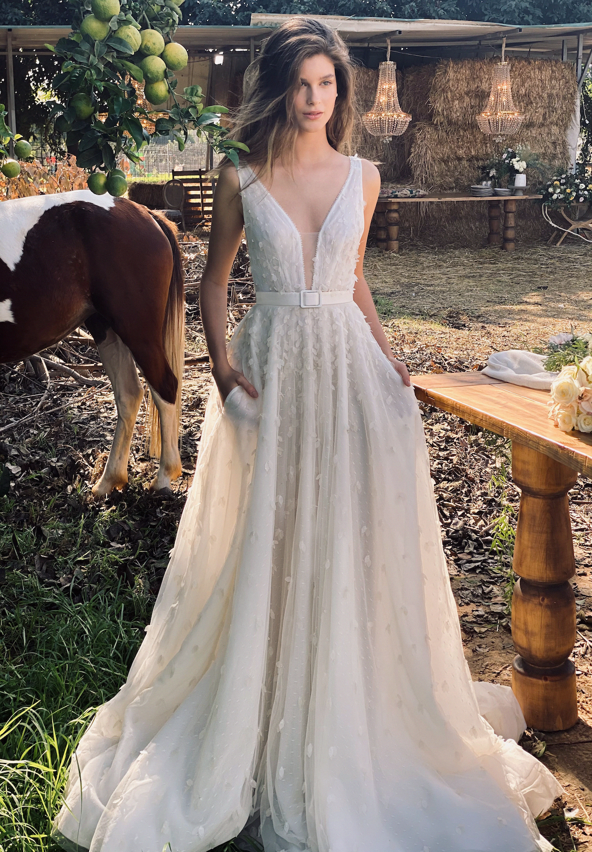 Floral beaded bridal gown with v-neck and a-line skirt