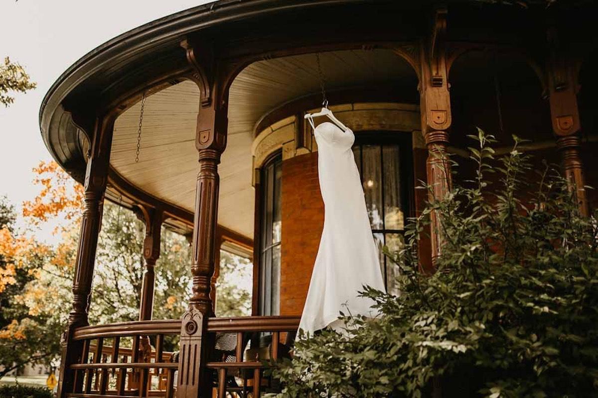 Wedding dress hangs outside at wedding venue