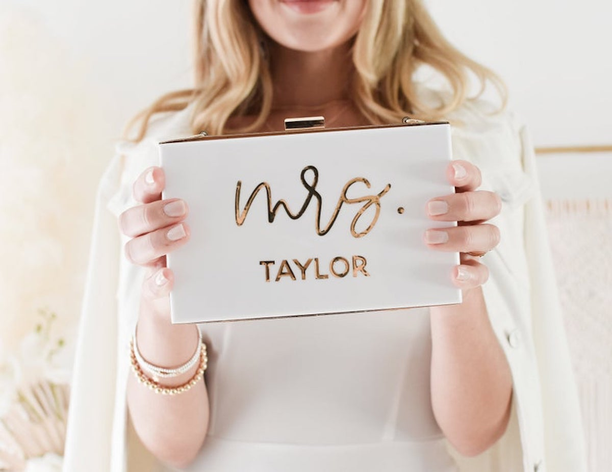 """Acrylic white and gold clutch for bride that says """"Mrs"""""""