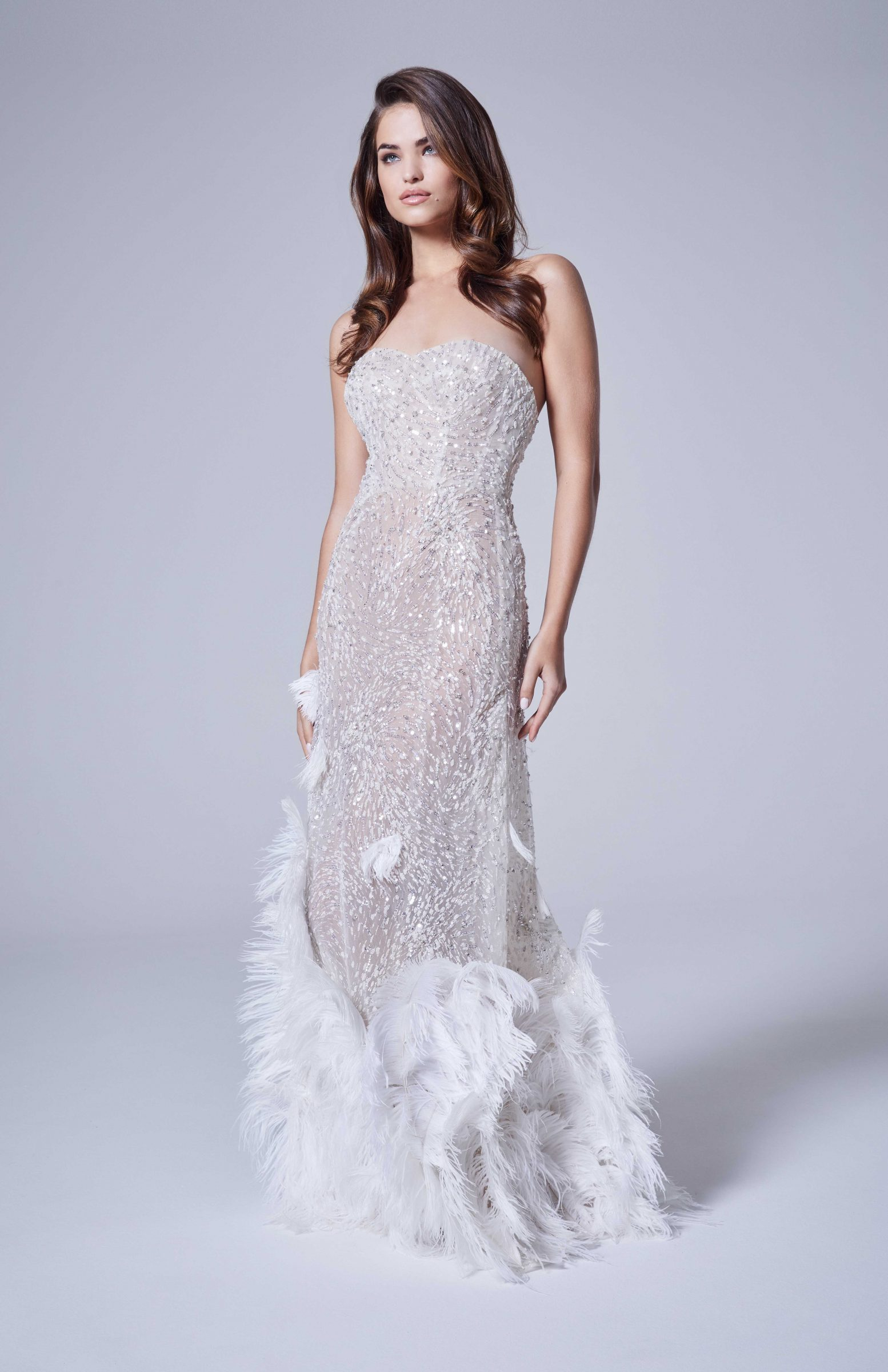 Sequin bridal gown with white feathers on bottom by Nicole + Felicia Couture