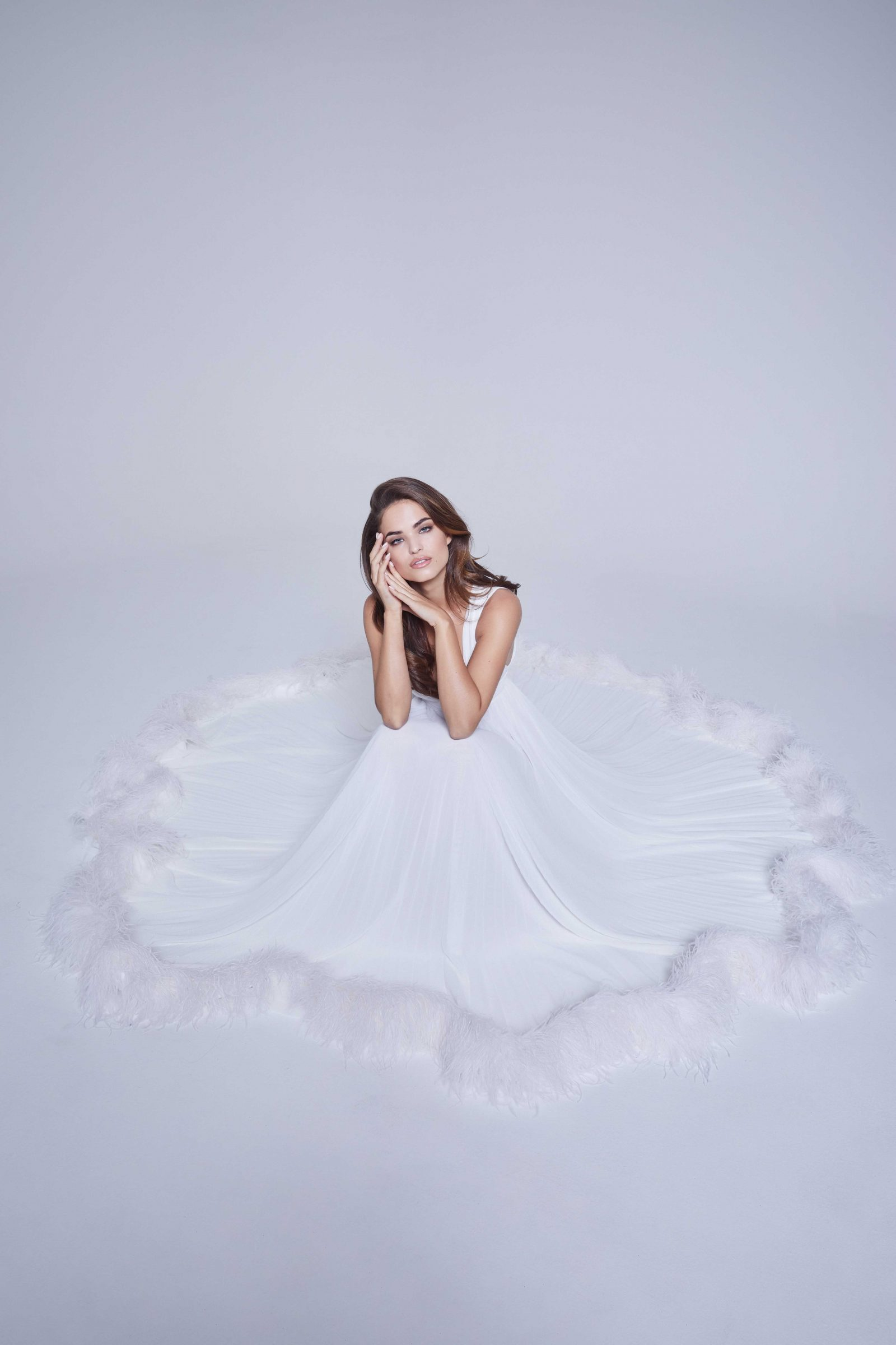 Bridal gown with feathers on bottom