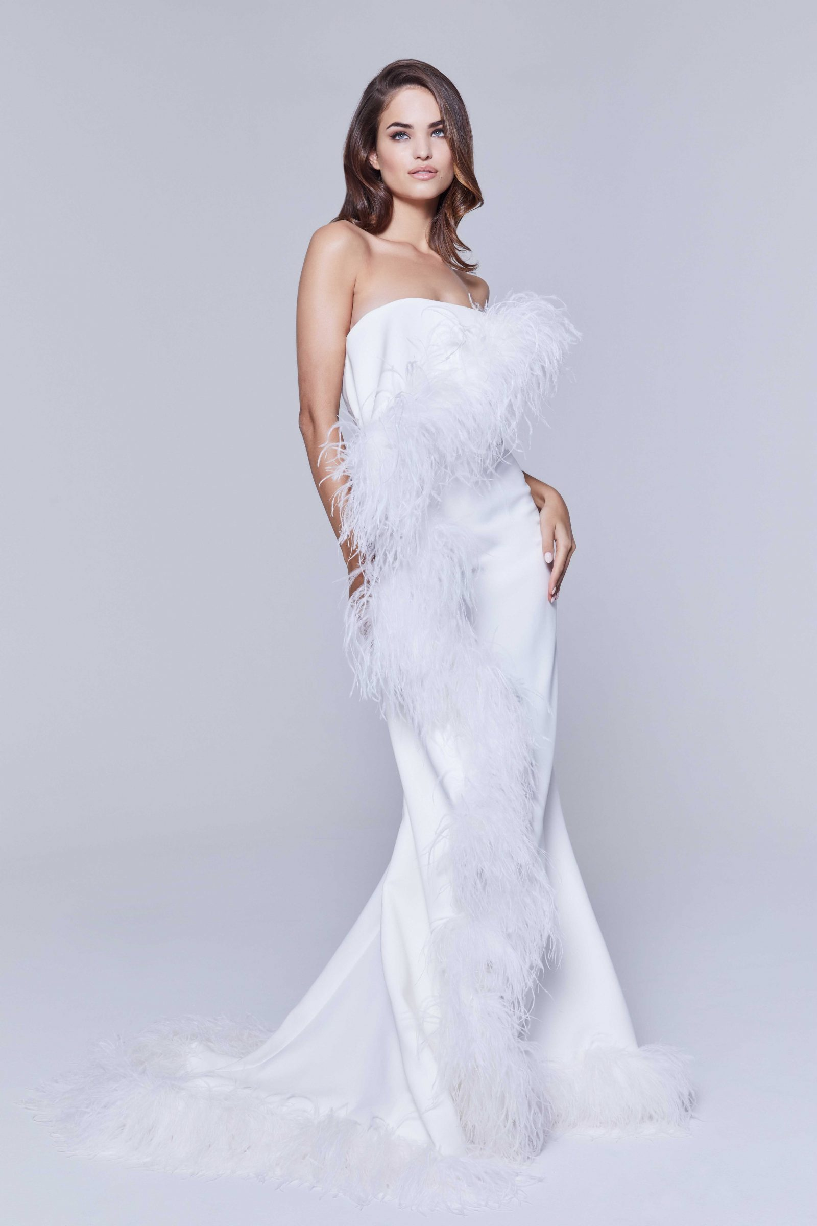 White bridal gown with white feathers