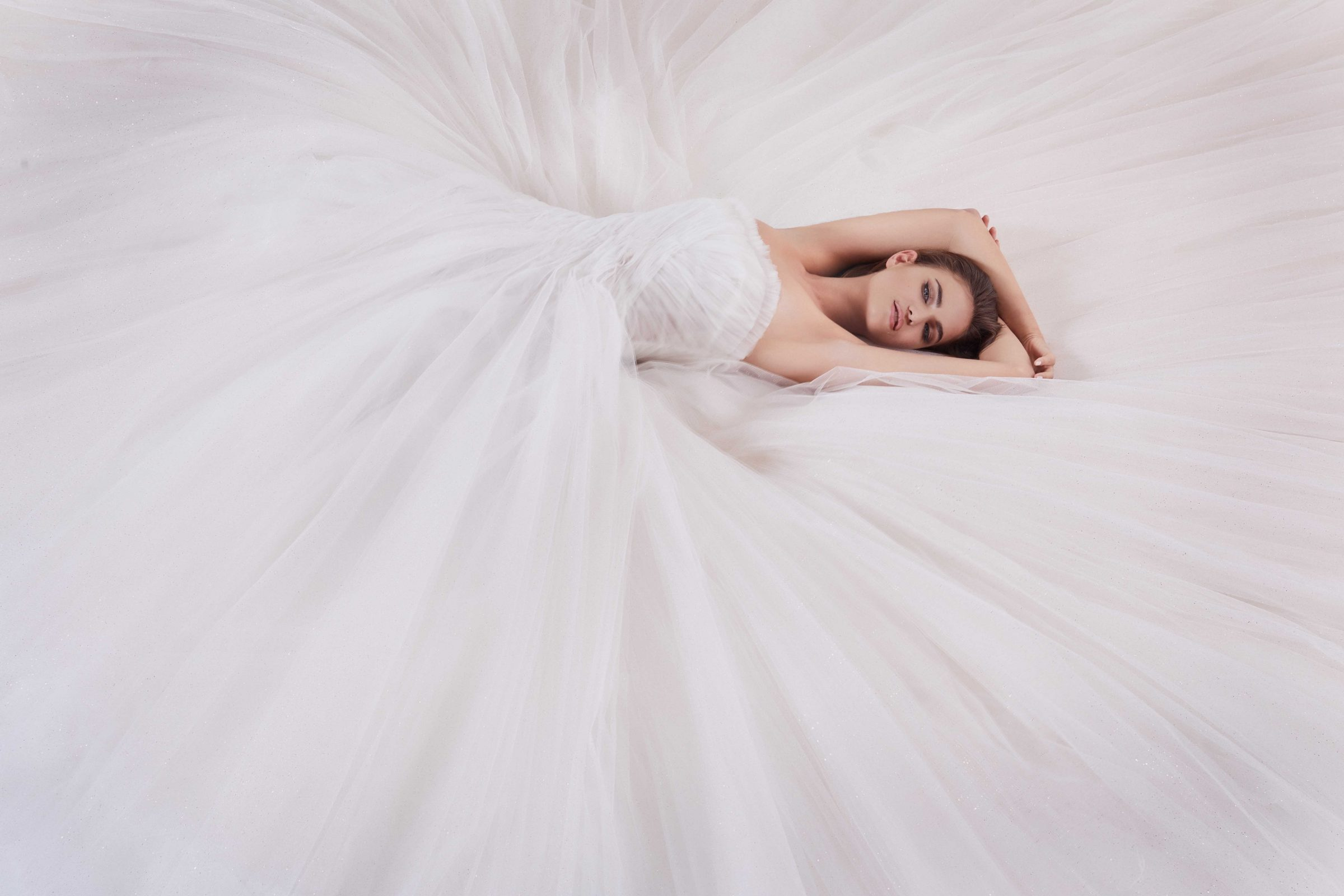 Strapless tulle blush bridal ballgown by Nicole + Felicia Couture