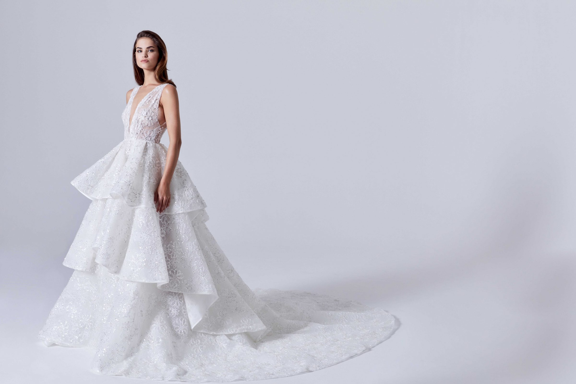 Deep V-neck embellished bridal gown with tiered skirt
