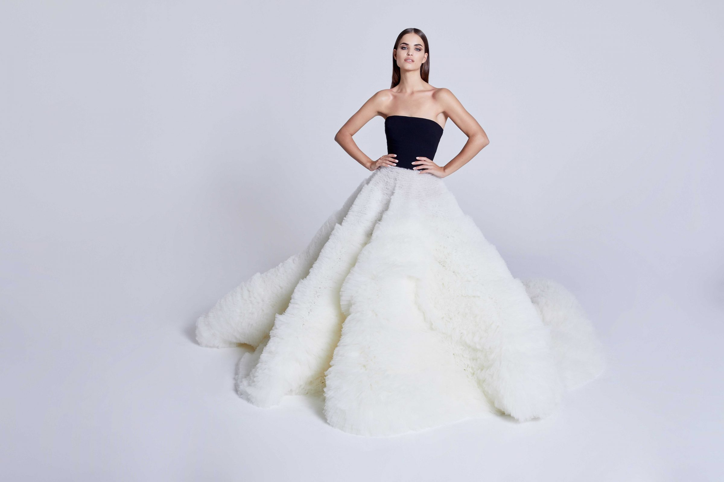 Ballgown wedding dress with black strapless top and flowing white bottom