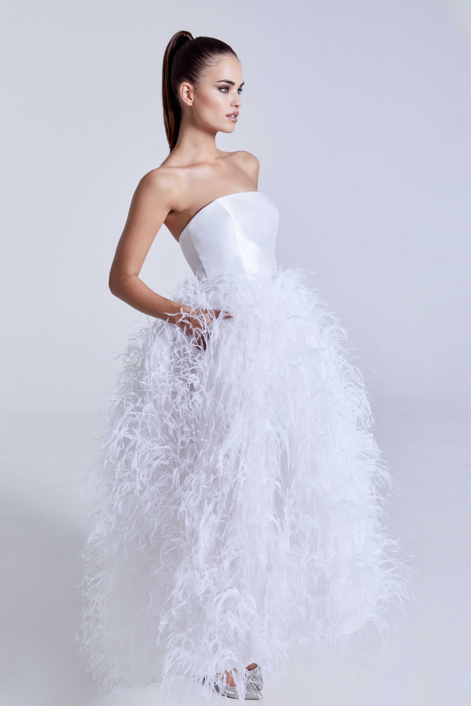 Simple strapless top bridal gown with feathered skirt