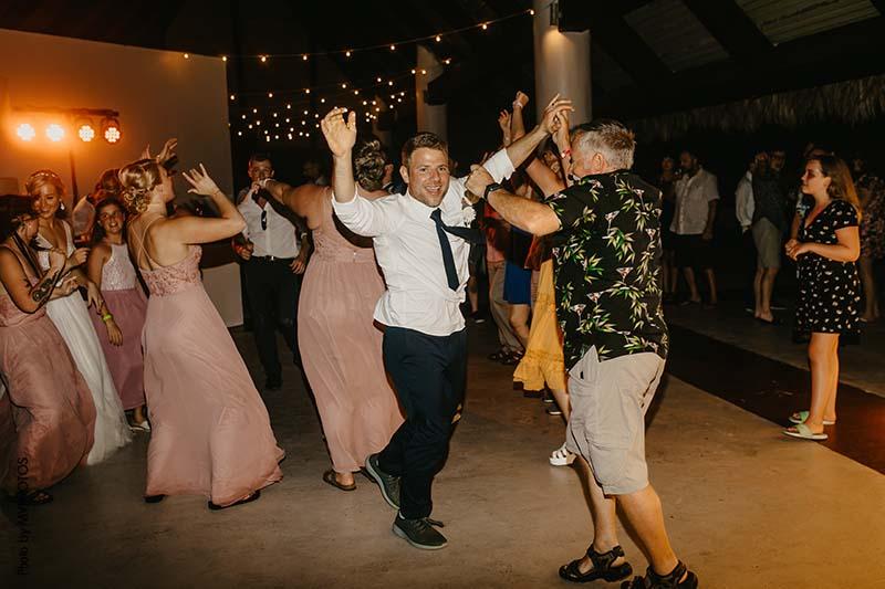 Groom dances at wedding reception