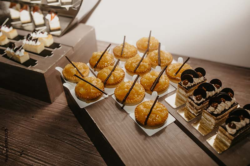 Dessert bar with pies and mini cakes at wedding reception