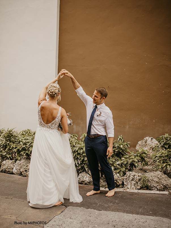 Groom twirls bride after sharing a first look