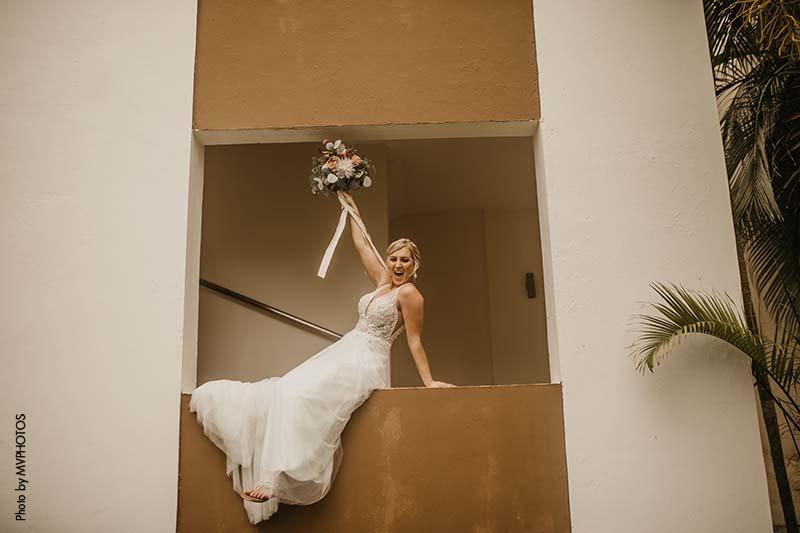 Minnesota bride sits on balcony at the Hard Rock Hotel Punta Cana