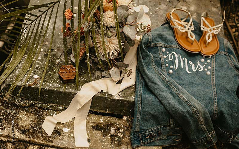 """Destination bride accessories with """"Mrs"""" jean jacket, sandals, and rings"""