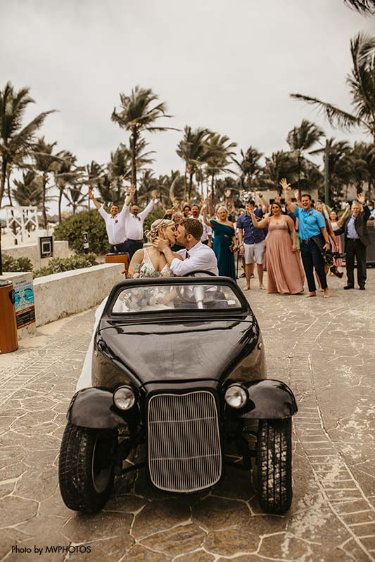 Wedding guests celebrate with new bride and groom in Punta Cana