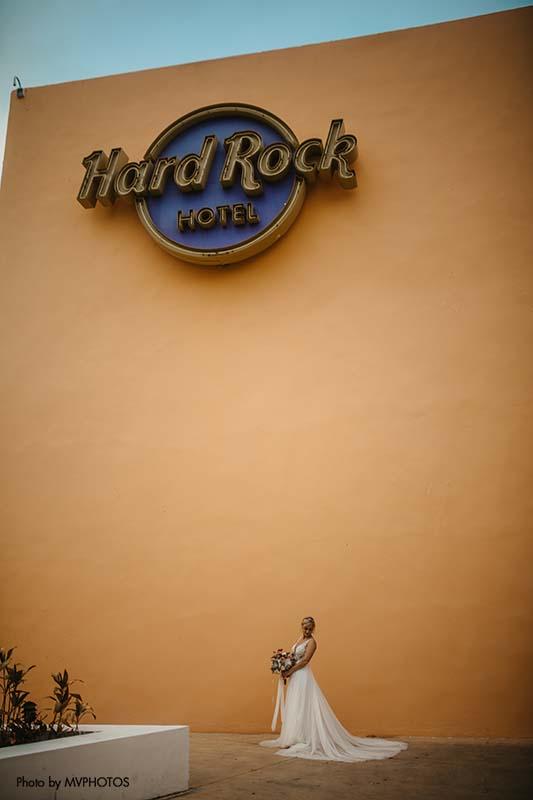 Bride stands against Hard Rock Hotel entrance
